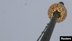 FILE - The Tiimes Square New Year's Eve ball is seen at One Times Square building during a test run before the official New Year's Celebration at Times Square in Manhattan, New York, Dec. 30, 2017.