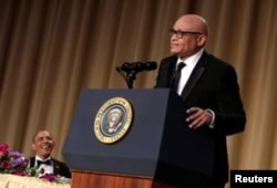 U.S. President Barack Obama, left, listens to comedian Larry Wilmore at the White House Correspondents' Association annual dinner in Washington, April 30, 2016.