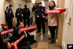 "Diana Colin, right, with the Coalition for Humane Immigrant Rights, shouts, ""McCarthy you have no heart,"" as the group from California protests outside the office of House Majority Leader Kevin McCarthy, Jan. 18, 2018, on Capitol Hill in Washington, in favor of the Deferred Action for Childhood Arrivals program."