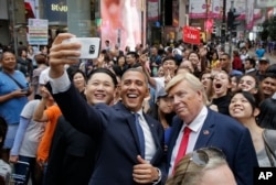 Impersonators of North Korean leader Kim Jong Un, former U.S. President Barack Obama and U.S. President Donald Trump take selfies in Hong Kong on July 4, 2017.