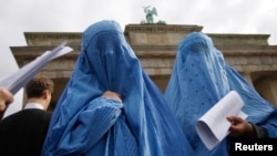 Protesters dressed in burqas attend a rally in front of the Brandenburg Gate, in Berlin, Germany, Sept. 20, 2008. If Germany enacts Merkel's ban, it would join the three other European countries - France, Belgium and the Netherlands - which aleady have their own specific bans on face-covering veils.