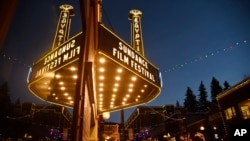 FILE - The marquee at the Egyptian Theatre appears on the eve of the 2017 Sundance Film Festival in Park City, Utah, Jan. 18, 2017.