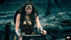 "FILE - This image released by Warner Bros. Entertainment shows Gal Gadot in a scene from ""Wonder Woman."""