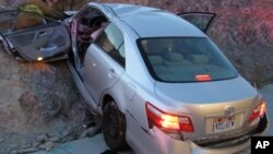 FILE - In this photo released by the Utah Highway Patrol, a Toyota Camry is shown after it crashed as it exited Interstate 80 in Wendover, Utah.