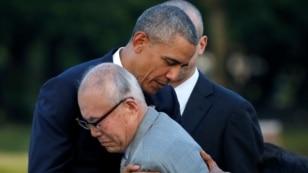 U.S. President Barack Obama (L) hugs atomic bomb survivor Shigeaki Mori as he visits Hiroshima Peace Memorial Park in Hiroshima, Japan, May 27, 2016.