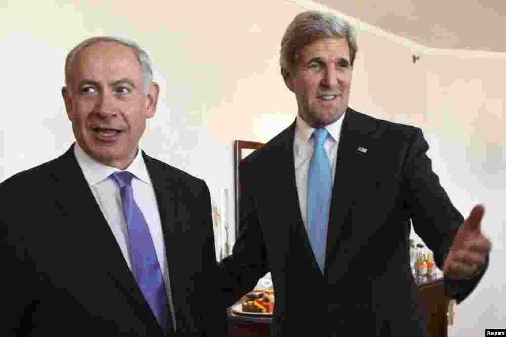 U.S. Secretary of State John Kerry gestures as he meets Israeli Prime Minister Benjamin Netanyahu in Jerusalem, June 28, 2013.
