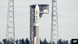 A United Launch Alliance Atlas V rocket that will launch to Mars arrives at Space Launch Complex 41 at the Cape Canaveral Air Force Station, Tuesday, July 28, 2020, in Cape Canaveral, Fla. (AP Photo/John Raoux)