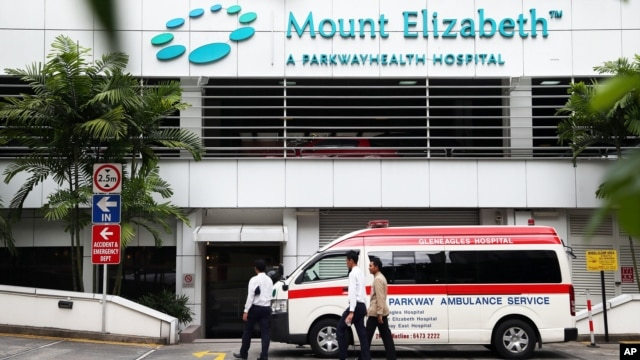 An ambulance is parked outside the Mount Elizabeth Hospital in Singapore, December 27, 2012.
