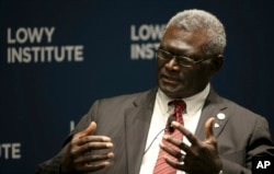 Manasseh Damukana Sogavare, Prime Minister of Solomon Islands, attends a Lowy Institute event in Sydney, in August, 2017, (AP Photo/Rick Rycroft)