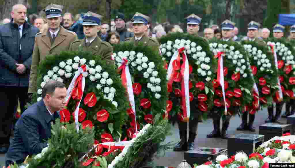 President Andrzej Duda (L) lays a wreath at the graves of the Presidential plane crash victims during a ceremony marking the 6th anniversary of the crash, at the Powazki Military Cemetery in Warsaw, Poland. President Lech Kaczynski, his wife Maria Kaczynska and 94 others died on 10 April 2010 when Polish presidential plane crashed in Smolensk, Russia.