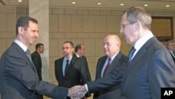 叙利亚总统阿萨德(左)和俄罗斯外长拉夫罗夫(右)2月7号在大马士革举行会晤