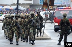 FILE - Liberian army soldiers walk on the Monrovia bridge during a training excercise as the United Nations Mission in Liberia forces (UNMIL) finally hands back security to Liberia's military and police, in Monrovia on June 24, 2016.