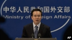 Chinese Foreign Ministry spokesman Hong Lei speaks during a news briefing at the Ministry of Foreign Affairs in Beijing, China, Thursday, Dec. 8, 2011. China, the world's most prolific executioner, put a Filipino man convicted of drug trafficking to death