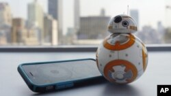 A photo shows Sphero's BB-8 droid toy in New York, Sept. 3, 2015. It's just under 5 inches tall and makes cute little Droid sounds reminiscent of R2-D2.