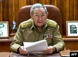 FILE - A screenshot from Cuban television shows President Raul Castro addressing the country, in Havana, Dec. 17, 2014.
