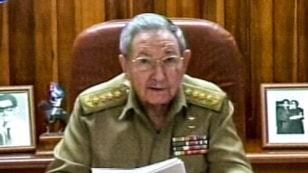 A screenshot from Cuban television shows President Raul Castro addressing the country, in Havana, Dec. 17, 2014.