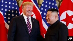 President Donald Trump meets North Korean leader Kim Jong Un, Feb. 27, 2019, in Hanoi. (AP Photo/ Evan Vucci)