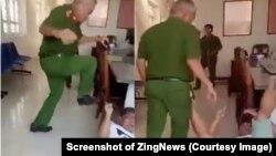 Trung tá Huỳnh Minh Lễ, Phó công an phường Phú Thạnh, dùng chân đạp người làm chứng đang nằm trên nền trụ sở công an phường. (Ảnh chụp màn hình Zing News)