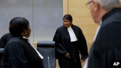 FILE - Prosecutor Fatou Bensouda (C) arrives for a hearing at the ICC in The Hague, Netherlands, Oct. 8, 2014. Bensouda announced in April she was opening a preliminary investigation into allegedly serious crimes being committed in Burundi.