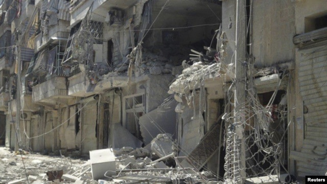 Damaged buildings in Aleppo's district of Salah Edinne, August 3, 2012.