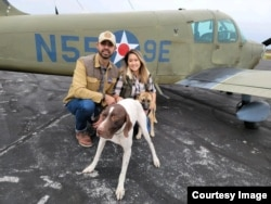 Pilot Eduard Seitan and his fiancee, Debbie, in front of his plane. They are preparing to deliver rescue dogs to their new home.