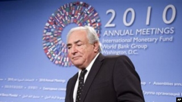International Monetary Fund (IMF) Managing Director Dominique Strauss-Kahn arrives for the opening news conference of the annual IMF and World Bank meetings, Thursday, Oct. 7, 2010, in Washington