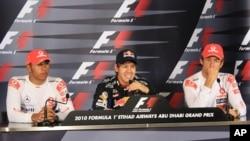 From left to right: Lewis Hamilton, Sebastian Vettel and Jenson Button following the Abu Dhabi Grand Prix.