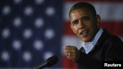 U.S. President Barack Obama speaks during a campaign rally in Hilliard, Ohio, November 2, 2012.