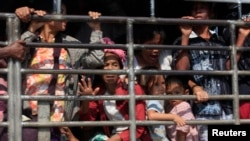 FILE - A group of Myanmar refugees are seen on a truck in Mae Sot, Thailand.