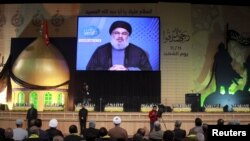 Pemimpin Hizbullah Lebanon, Sayyed Hassan Nasrallah menyampaikan sambutan dalam peringatan hari Martir di daerah sub-urban Beirut, Lebanon, 11 November 2015 (Foto: dok).