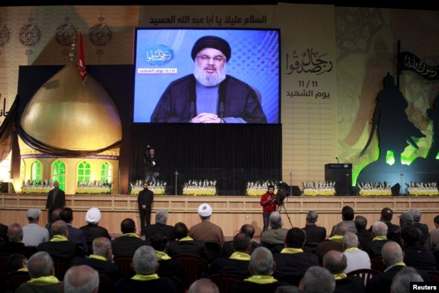 """FILE - Lebanon's Hezbollah leader Sayyed Hassan Nasrallah addresses his supporters in Lebanon. Saudi anger at the power of Iran-backed Hezbollah in Lebanon is growing, with Gulf governments labelling Hezbollah a """"terrorist group"""" and placing sanctions on a number of companies and individuals accused of being Hezbollah affiliated."""