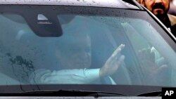 FILE - Pakistan's ousted Prime Minister Nawaz Sharif waves to supporters from his car while he leaves after appearing in an accountability court in Islamabad, Pakistan, Wednesday, Nov. 15, 2017.