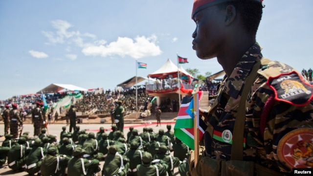 A Sudan People's Liberation Army (SPLA) soldier watches on during a parade celebrating their 29th anniversary in South Sudan's capital Juba, May 16, 2012.