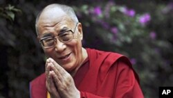Tibetan spiritual leader the Dalai Lama smiles following an interview with AP outside his residence in Dharmsala, northern India. (file photo)