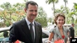 شام کے صدر بشار الاسد اور ان کی اہلیہ اسما