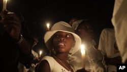 A group of Haitians mark the first anniversary of the magnitude-7.0 earthquake with a candlelight vigil and march in Port-au-Prince, 12 Jan., 2011.