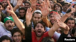 Supporters of the political party Pakistan Tehreek-e- Insaf (PTI) shout slogans during a rally in Lahore, March 23, 2013.