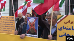 "Iranian American protesters chant ""Death to Khamenei"" and ""Death to Rouhani"" as Iran's foreign minister Mohammad Javad Zarif appears at the Council on Foreign Relations in New York, April 23, 2018."