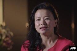 Gambar file tak bertanggal dari video handout oleh Departemen Luar Negeri dan Perdagangan Australia (DFAT) / Alumni Global Australia pada 1 September 2020 menunjukkan jurnalis Australia Cheng Lei di lokasi yang tidak diketahui. (AFP)