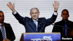FILE - Israeli Prime Minister Benjamin Netanyahu waves to supporters at the party headquarters in Tel Aviv, March 18, 2015.