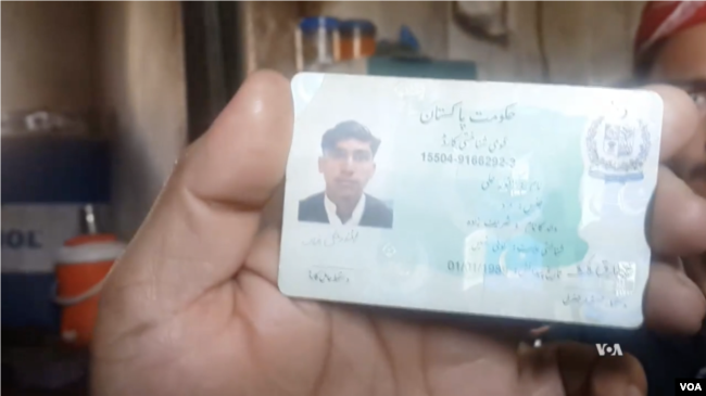 An ethnic Pashtun shows his ID card in Bajaur, Pakistan. Pashtuns say they are being harassed by police and undergoing racial profiling.