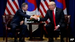 President Donald Trump shakes hands with South Korean President Moon Jae-In at the Lotte New York Palace hotel during the United Nations General Assembly, Sept. 24, 2018, in New York.