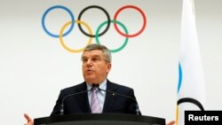 International Olympic Committee (IOC) President Thomas Bach announces the 2022 Olympic Winter Games candidate cities at the IOC headquarters in Lausanne, Switzerland, July 7, 2014.