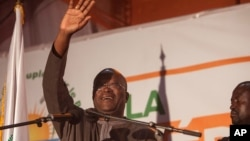 Newly elected president of Burkina Faso, Roch Marc Kabore, waves at supporters after preliminary results showed him to be the winner of recent elections, outside his campaign headquarters in Ouagadougou, Burkina Faso, Dec. 1, 2015. Kabore took the oath of office on Dec. 29, 2015.