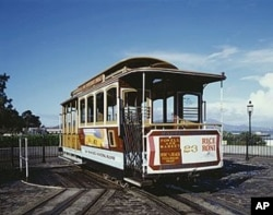 Near the famous Fisherman's Wharf, a cable car reverses direction for a return trip downtown atop a turntable similar to those found in old railroad roundhouses.