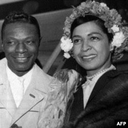 """Nat """"King"""" Cole, and his wife Maria, arrive at London airport May 12, 1960"""