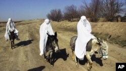 Afghanes dans le district de Sholgara, dans la province de Balkh, en Afghanistan, le 13 mars 2008.