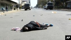 FILE: A woman lies in the road after been injured by police during protests in Harare, Friday, Aug, 16, 2019. This is the woman Doubt Asima tried to help.