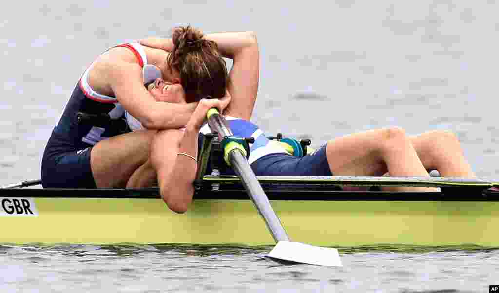 Great Britain's Heather Stanning and Helen Glover celebrate after winning the gold medal for the women's rowing pair in Eton Dorney.