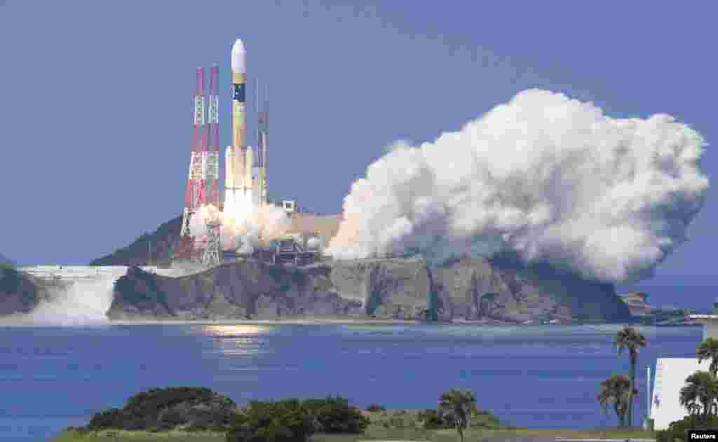 A H-IIA rocket carrying Michibiki 3 satellite, one of four satellites that will augment regional navigational systems, lifts off from the launching pad at Tanegashima Space Center on the southwestern island of Tanegashima, Japan, in this photo taken by Kyodo, Aug. 19, 2017.